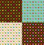 Set of patterns with hearts. 4 vector seamless patterns with hearts Stock Photos