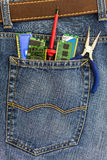 Set of PC service tools in a back pocket of  jeans Royalty Free Stock Photos