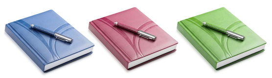 Set pen and a color notebook Royalty Free Stock Photo