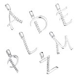 Set of pendants in the shape of alphabet Stock Images