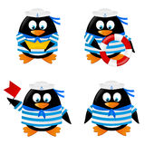 Set of penguins sailors Stock Photos