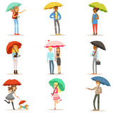 Set of people with colorful umbrellas. Smiling man and woman walking under umbrella colorful characters vector Royalty Free Illustration