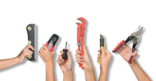 Set of peoples hands holding tools. Set of peoples hands holding different tools from below on isolated white background Stock Images