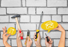 Set of peoples hands holding tools Stock Photo