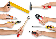 Set of peoples hands holding tools. Set of peoples hands holding different tools on isolated white background stock images