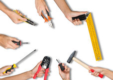 Set of peoples hands holding tools. Set of peoples hands holding different tools on isolated white background stock photo