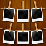 Set of photo frames on the rope with clothespin. Photo frames set on wood Stock Photo