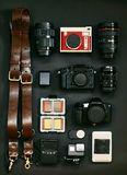 Set of photographer for travel. The layout of the cameras. My set of photo equipment royalty free stock images
