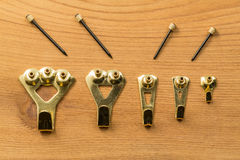 Set of picture hanging hooks and nails Royalty Free Stock Images