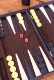 Set pieces and dice for the game of backgammon. Stock Photos