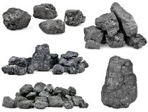 Set of piles of coal  on white. Background Stock Photo