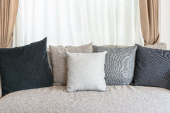 Set of pillows on modern sofa with white curtain Stock Photography