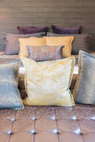 Set of pillows on sofa in modern bedroom Royalty Free Stock Photography