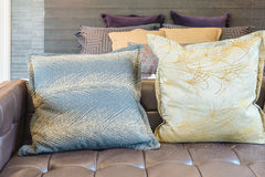 Set of pillows on sofa in modern bedroom Royalty Free Stock Images