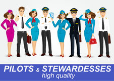 Set of pilots and two stewardesses in uniform Stock Photos