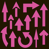 Set of 13 pink arrows. On a black background Royalty Free Stock Images