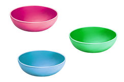 Set of Pink blue and green plastic Pet bowls Stock Photography