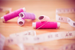 Set of pink colorful sewing threads Stock Images