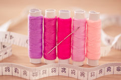 Set of pink colorful sewing threads Royalty Free Stock Photography