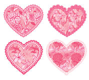 Set of 4 Pink fine lace hearts with floral pattern. Stock Photos
