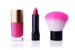 Set of pink nail polish, lipstick and make-up brush Stock Photos