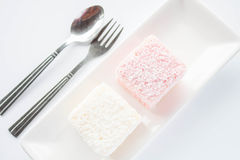 Set of pink and white lamington sponge cakes Royalty Free Stock Images