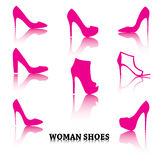 Set of pink woman shoes silhouettes with reflections. Set of woman shoes silhouettes with reflections. Pink purple female fashion icons isolated on white. Vector Royalty Free Stock Photos