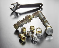 A set of pipe fittings and an adjustable spanner Royalty Free Stock Image