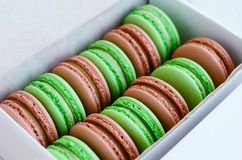 Set of pistachio and caramel macaroon in white box Stock Images