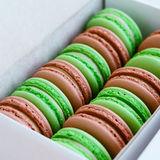 Set of pistachio and caramel macaroon in white box, square Stock Images