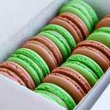 Set of pistachio and caramel macaroon in white box, square Royalty Free Stock Photo