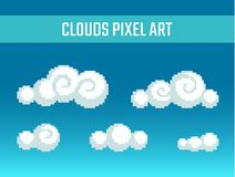 Pixel art stylized clouds. Set of pixel art stylized clouds different forms Royalty Free Stock Photo