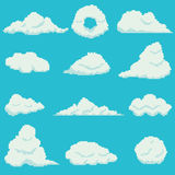Set of 12 pixel clouds. On blue background Royalty Free Stock Image