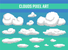 Set of pixel clouds on blue background. Old school computer graphic style Stock Photo