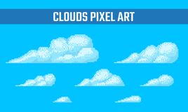 Set of pixel clouds on blue background. Set of pixel clouds with dithering effect on blue background. Old school computer graphic style Stock Images