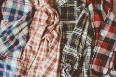 Set of plaid shirts on the table Stock Image