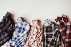 Set of plaid shirts on the table Royalty Free Stock Images