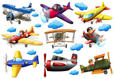 Set of planes. In different colours on a white background Royalty Free Stock Image