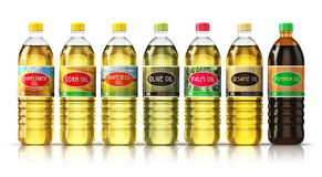 Set of plasic bottles with vegetable cooking oils Royalty Free Stock Photo
