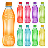 Set of plastic bottles with multicolored juices Royalty Free Stock Photography