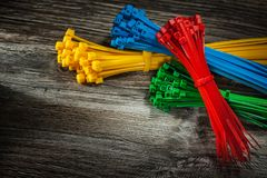 Set of plastic cables on wooden board stock images