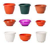 Set of plastic flowerpots for indoor plants Stock Photos