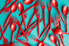 Set of plastic forks and spoons isolated on blue Stock Photos