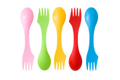 Set of plastic varicolored camping cutlery tools Royalty Free Stock Image