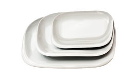 Set of plates. Set of white plates over white background Stock Photo