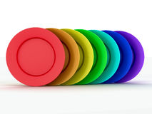 Set of plates in colours a rainbow Stock Images