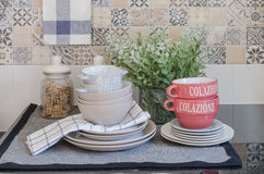 Set of plates and dish on counter in kitchen room Royalty Free Stock Photo