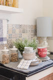 Set of plates and dish on counter in kitchen room. At home Royalty Free Stock Image