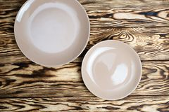 Empty brown plate on wooden table Stock Photo