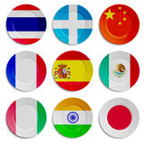 Set of plates with flags isolated on white Royalty Free Stock Photo